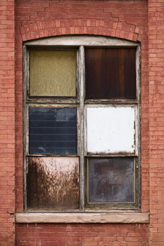 A boarded up window shows the ravages of time in Silverton, Colorado. Prints available in any size; please contact us for details.