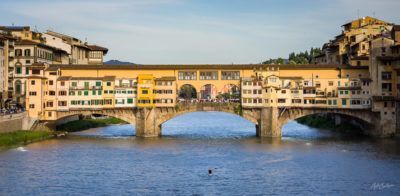 Travel Photograph: Ponte Vecchio and Lone Rower by Nat Coalson