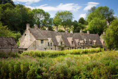 A row of historic houses, originally built in 1380 as monastic wool stores, is a well-known historic landmark in Bibury, Gloucestershire, United Kingdom.