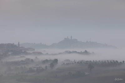 Early morning fog rises from the hills to the east of the Langhe region in Piedmont, Italy.